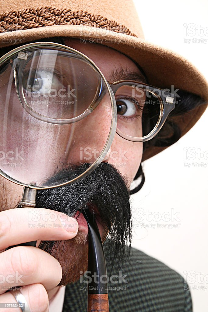 Detective Inspector With Mustache, Pipe, & Magnifying Glass stock photo