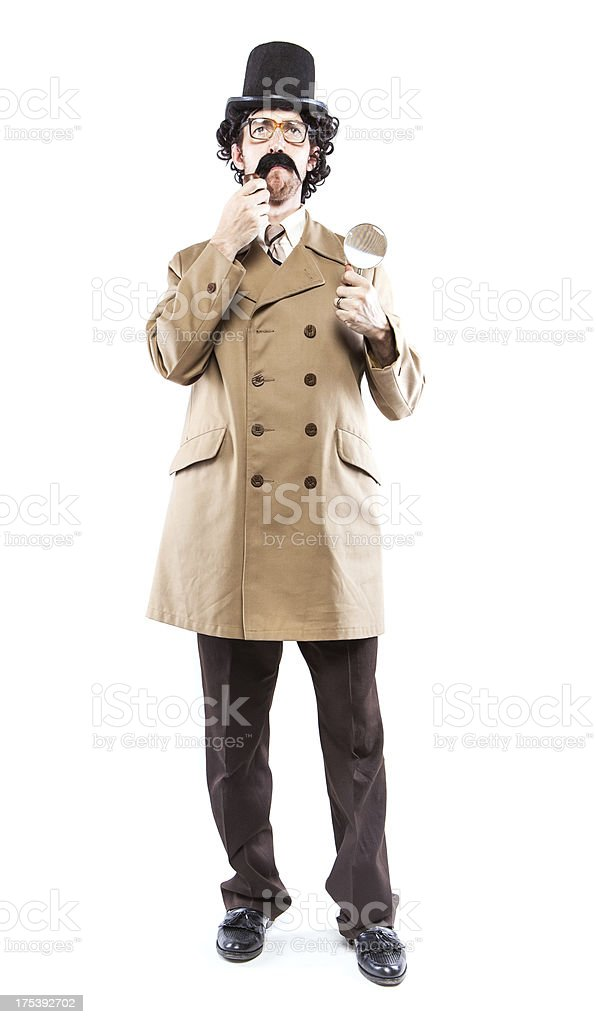Detective Inspector With Pipe & Magnifying Glass royalty-free stock photo