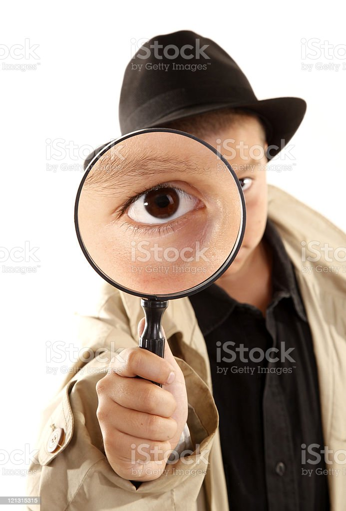 Detective kid investigate with magnifying glass stock photo