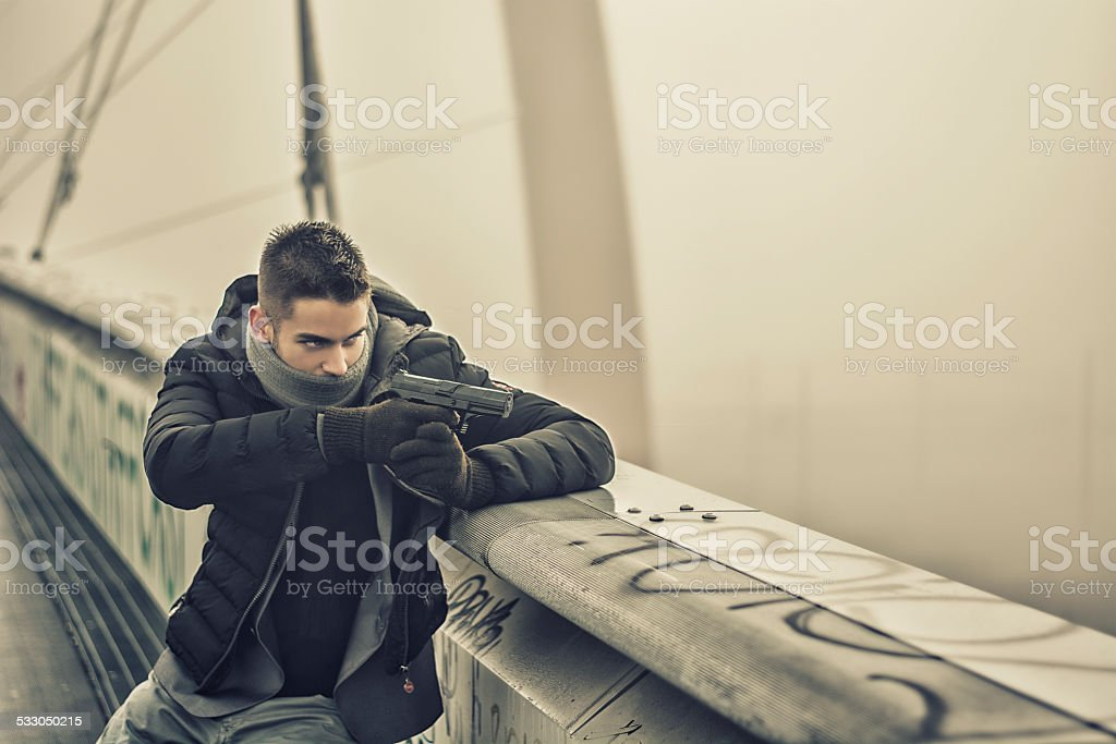 Detective, mobster or policeman aiming a gun stock photo