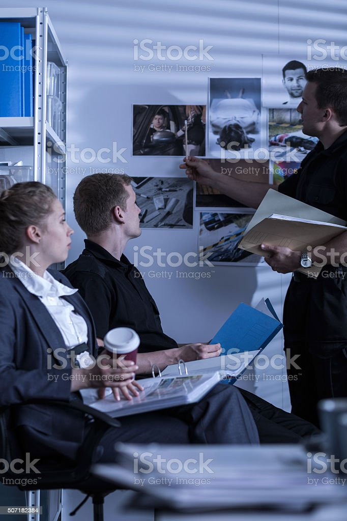 Detective searching files stock photo