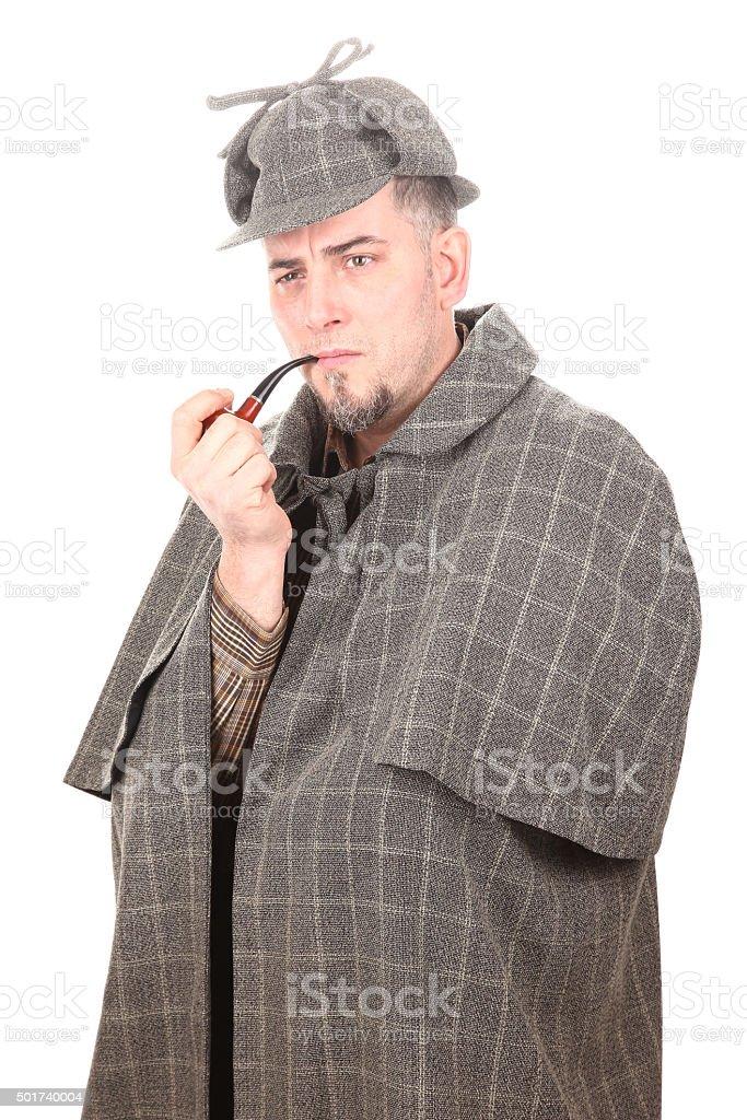 Detective Sherlock Holmes portrait with smoking pipe on white stock photo