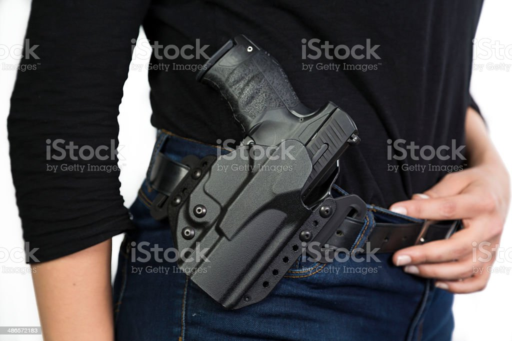 Detective with gun on her belt stock photo