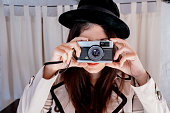 Detective Woman taking photo