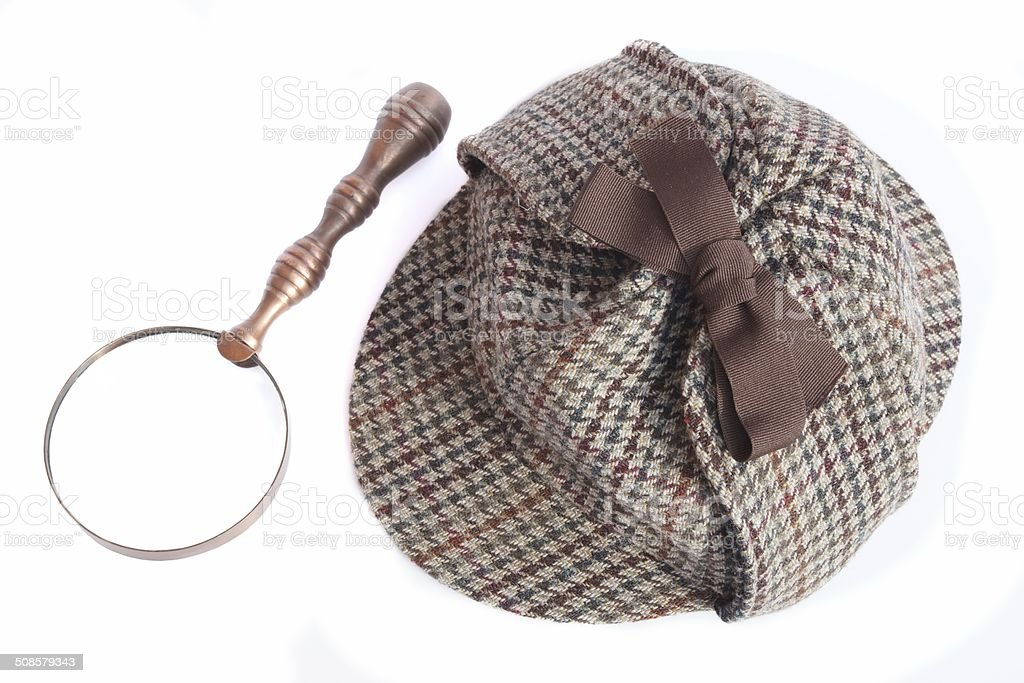 Detectives Deerstalker Hat And Magnifier Isolated On White stock photo