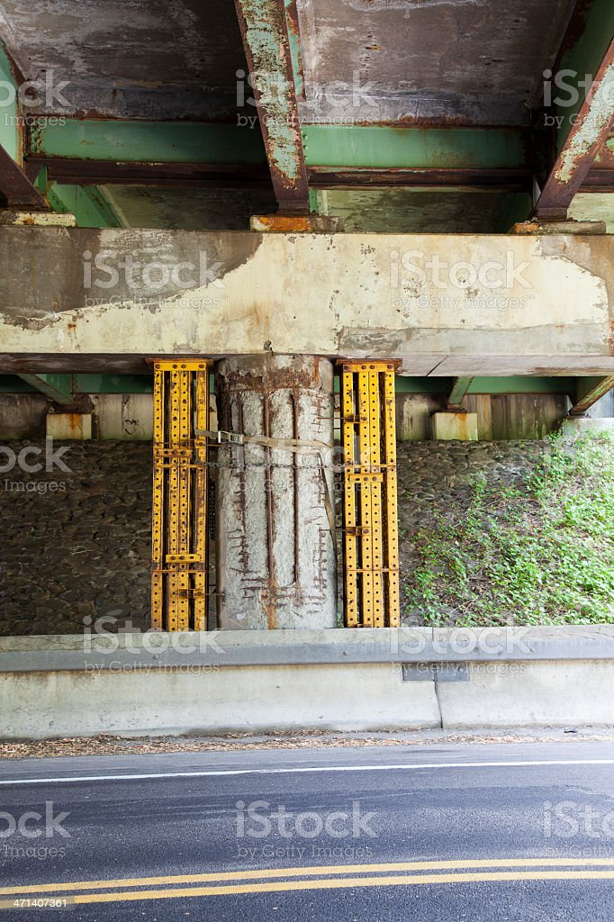 Deteriorating Bridge Support Pillar with Metal Shoring Vertical royalty-free stock photo