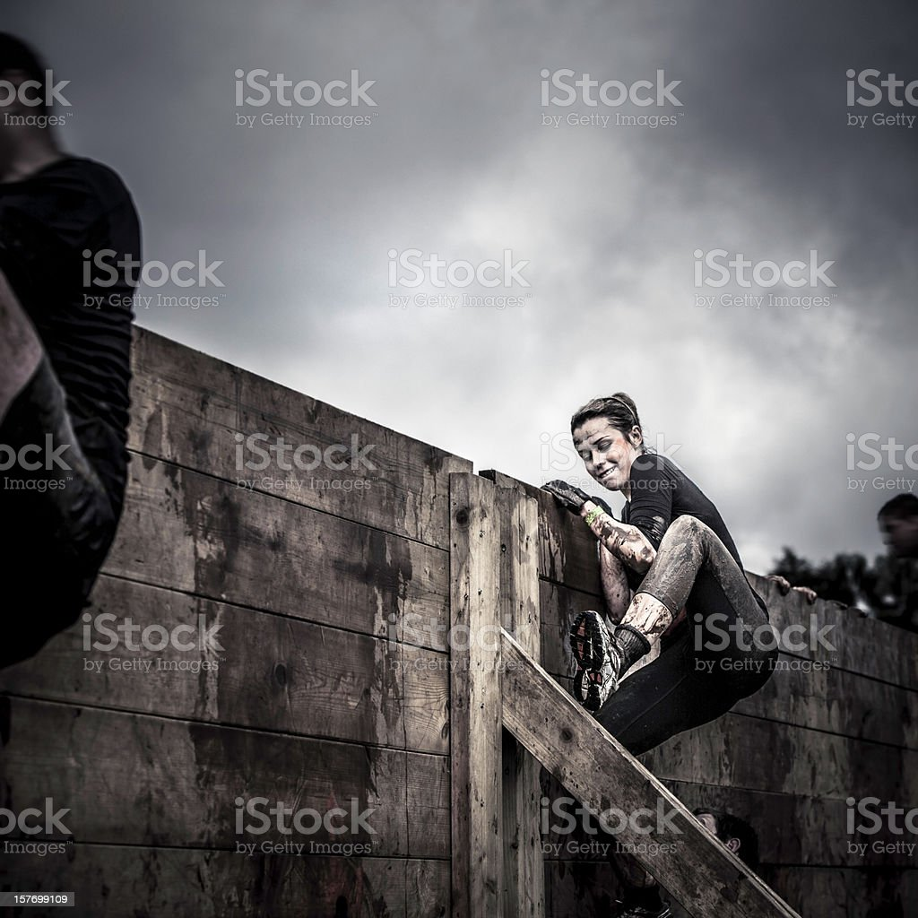 Determination: Female athlete in competition stock photo