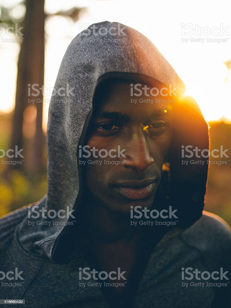 Determined african-american cross-country athlete planning his r stock photo