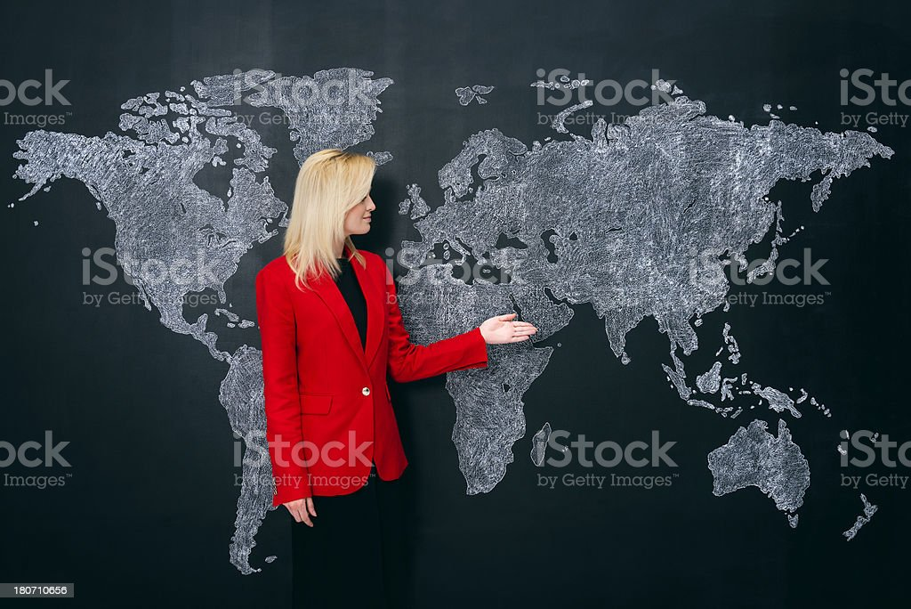Determined businesswoman and world map royalty-free stock photo