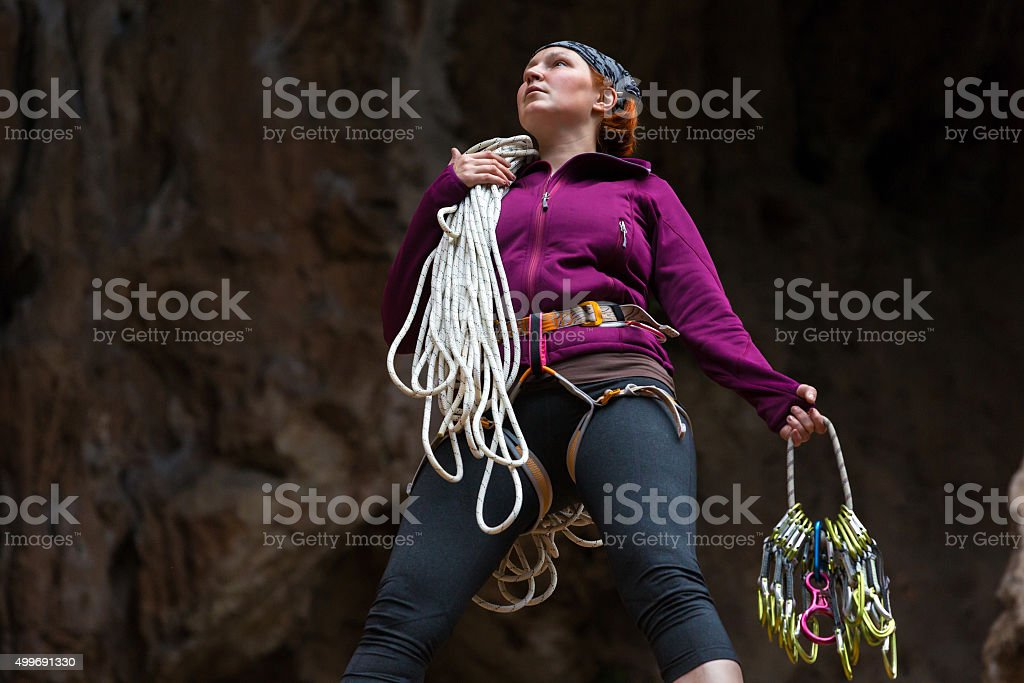 Determined Female Climber holding rope and gear stock photo