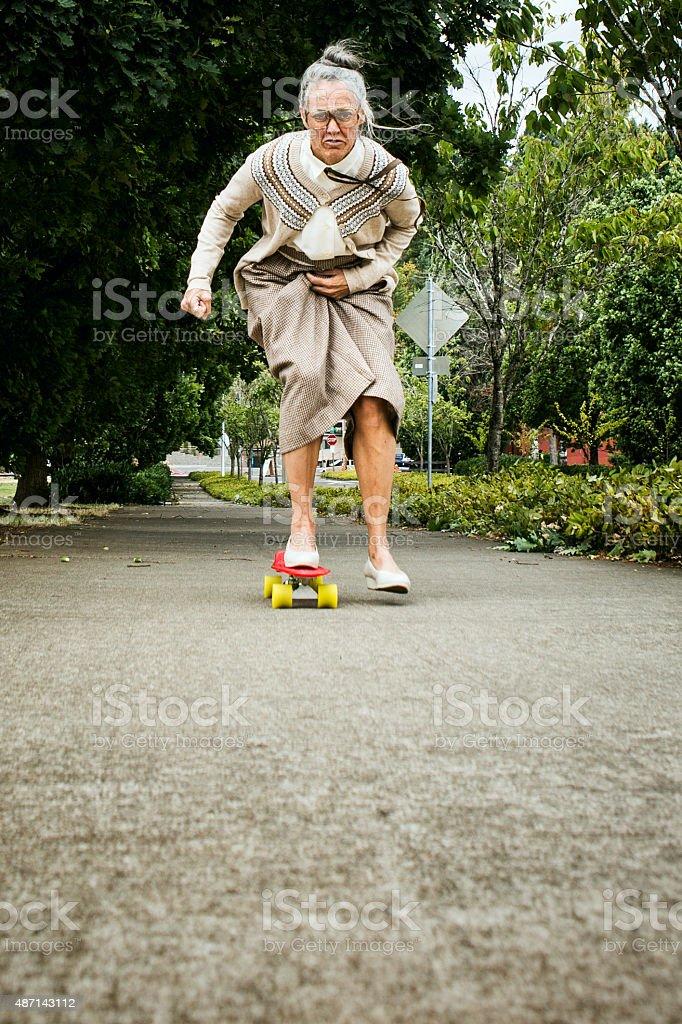 Determined Grandma on Skateboard stock photo