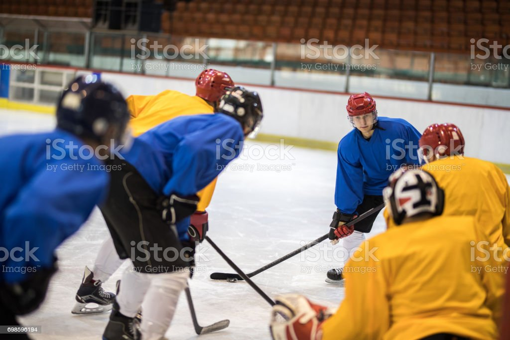 Determined ice hockey player in action on a sports match. stock photo