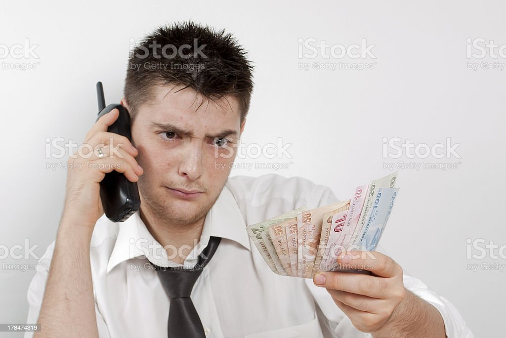 Determined Man On The Phone Thinking About Money royalty-free stock photo