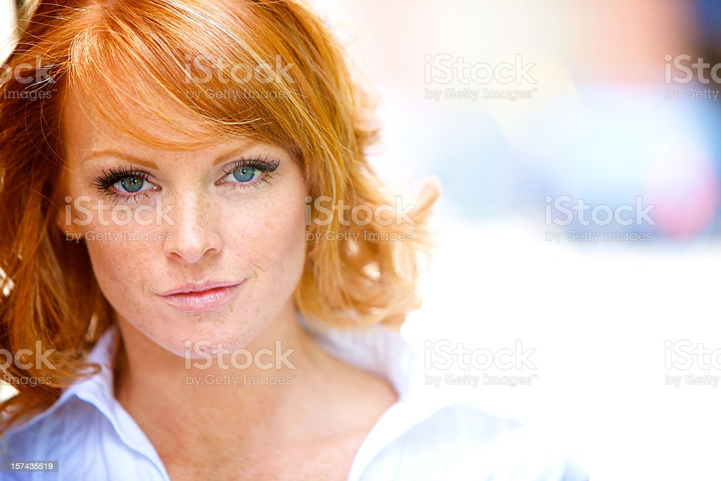 determined red hair woman portrait stock photo