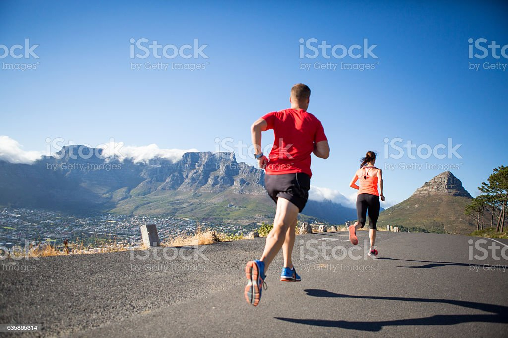 Determined to catch my female running partner stock photo