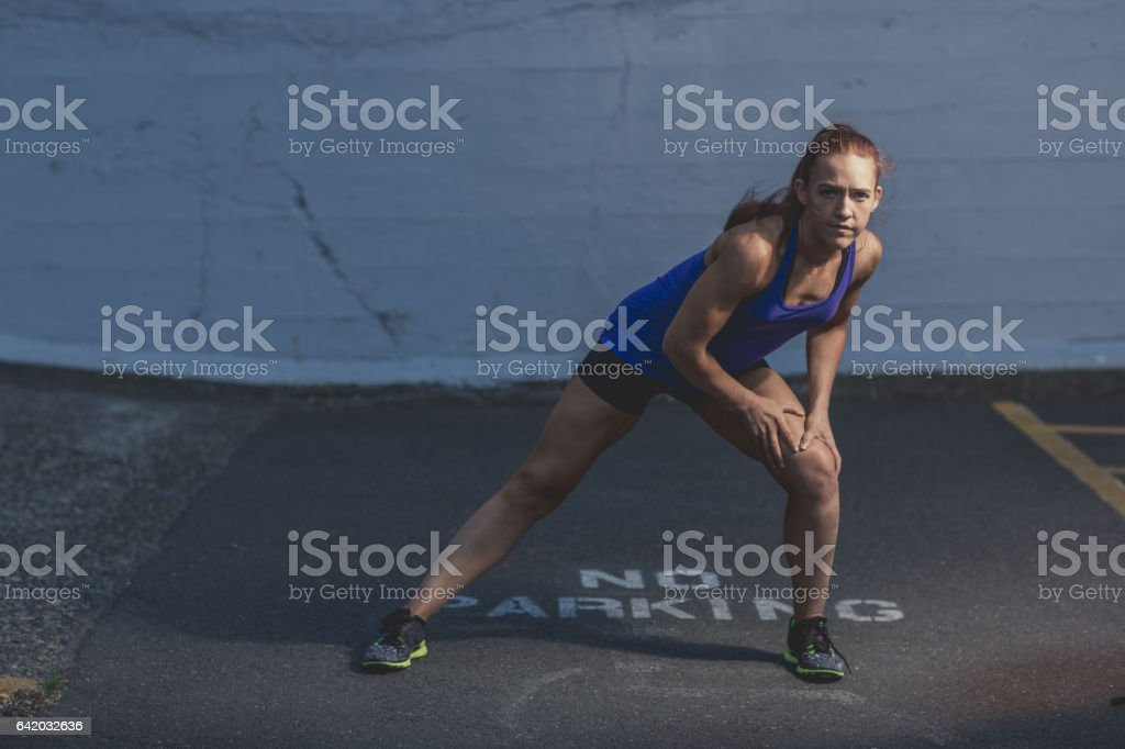 Determined Woman in Starting Pose stock photo