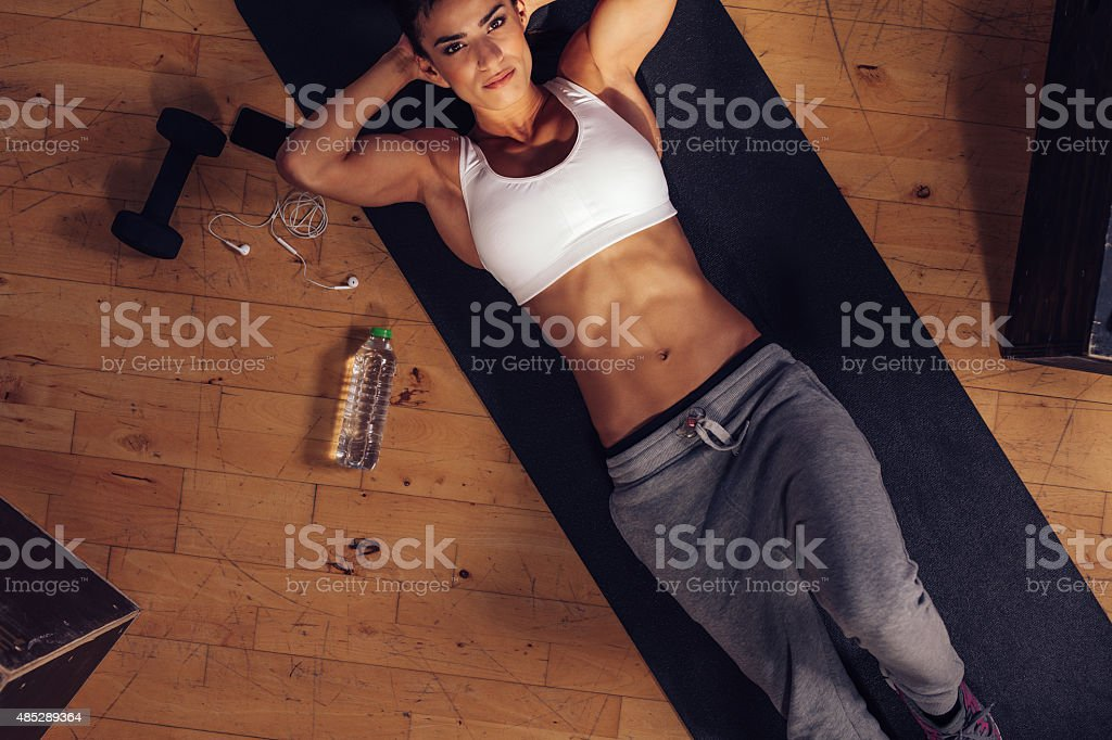 Determined woman ready to do sit-ups stock photo