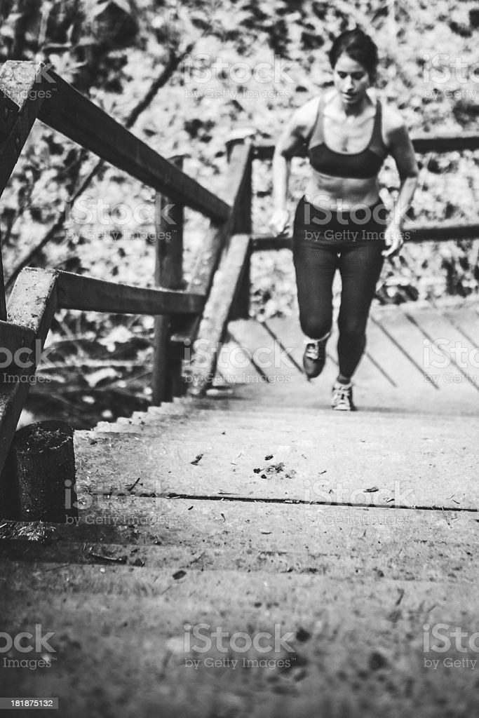 Determined Woman Running Stairs royalty-free stock photo