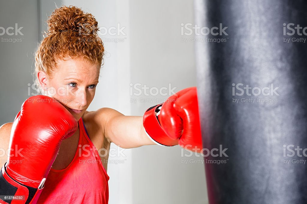 Determined young female boxer. stock photo