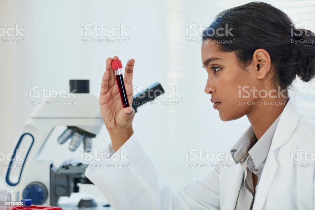 Determining the root cause of her latest medical case stock photo