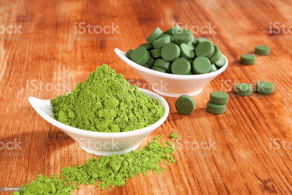 Detox. Chlorella and wheat grass. stock photo