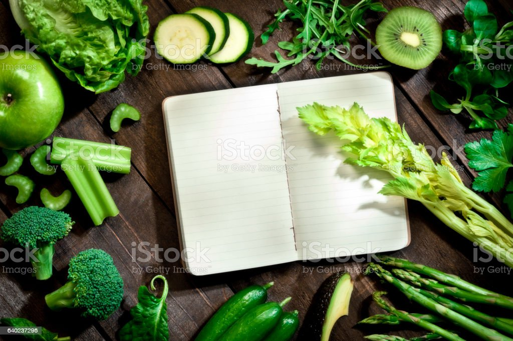 Detox diet concept: blank recipe book with detox vegetables stock photo