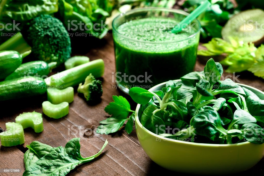 Detox diet concept: green vegetables on wooden table stock photo