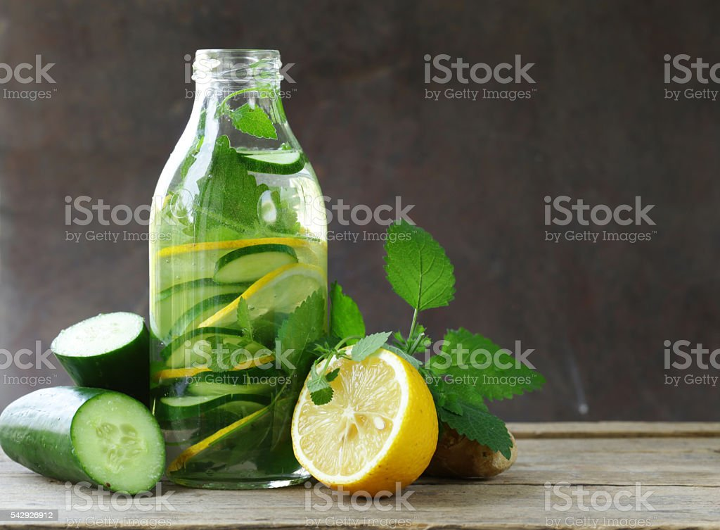 detox drink with fresh cucumber, lemon and ginger stock photo