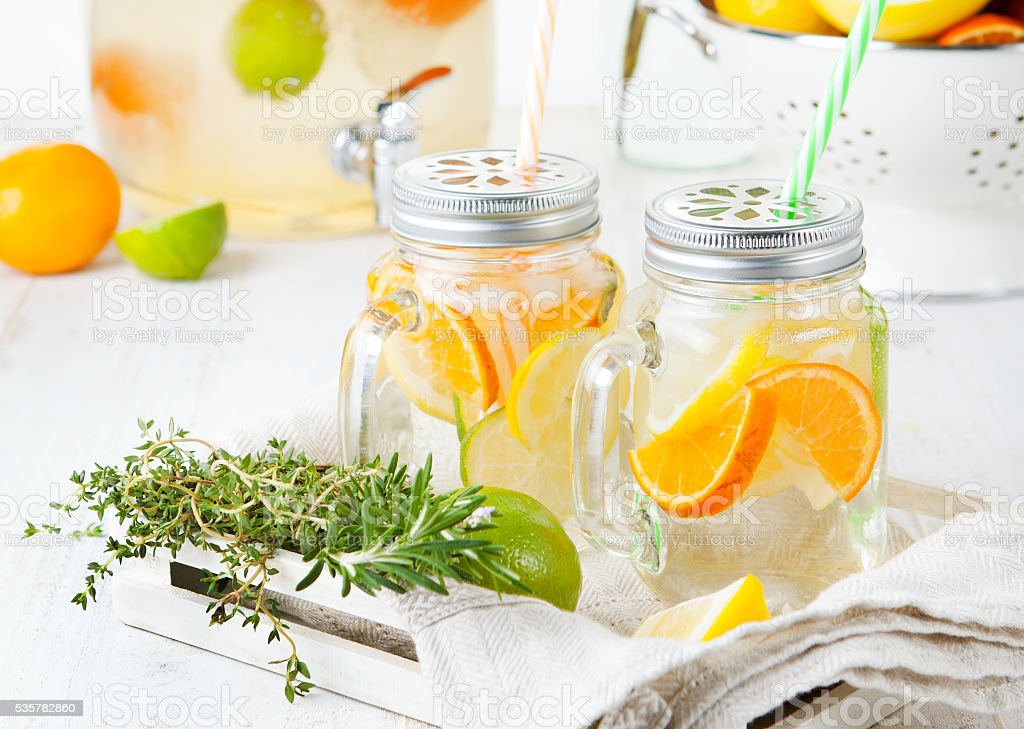 Detox fruit infused flavored water. Refreshing summer homemade lemonade cocktail stock photo