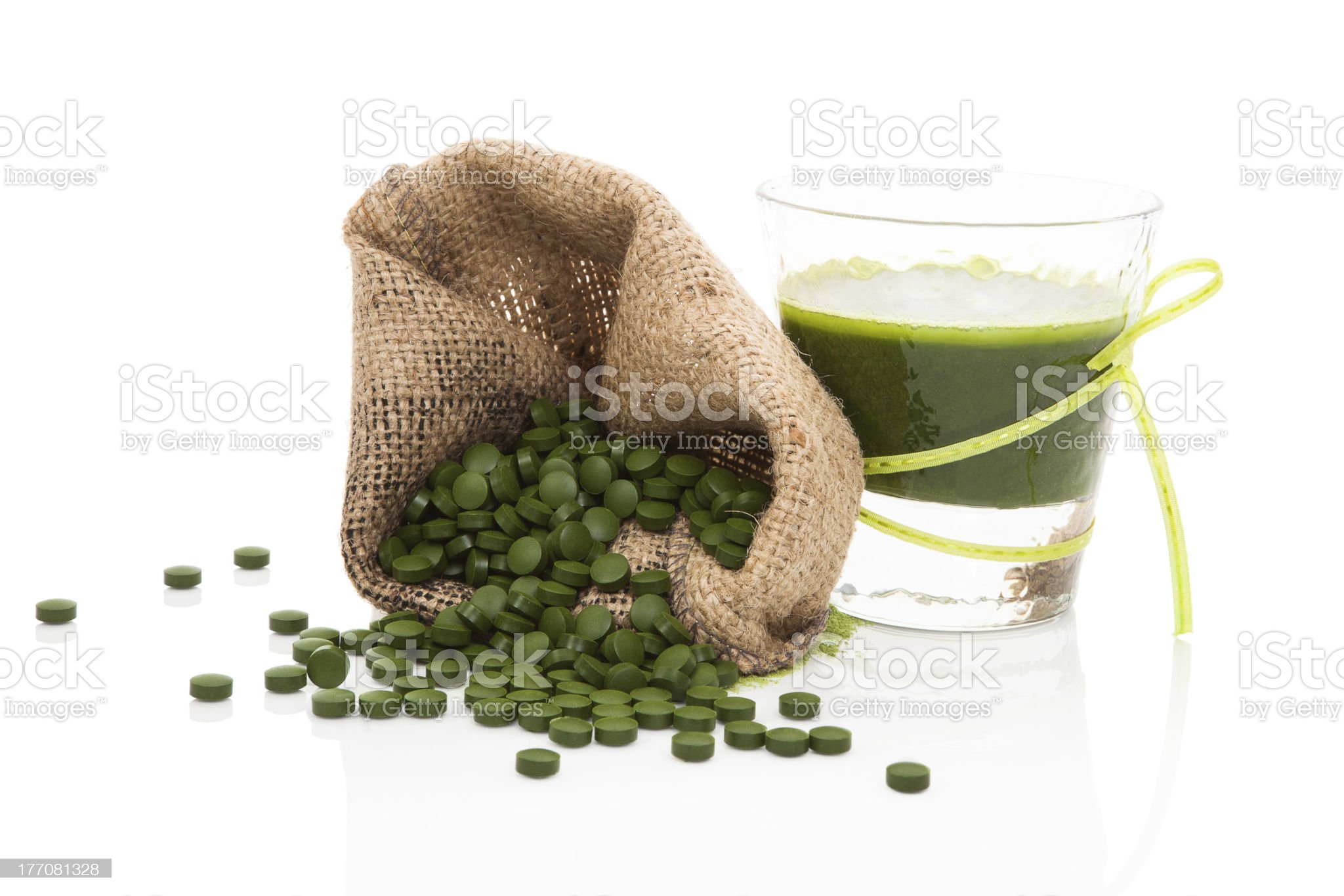 Detox. Green pills with vegetable juice. royalty-free stock photo