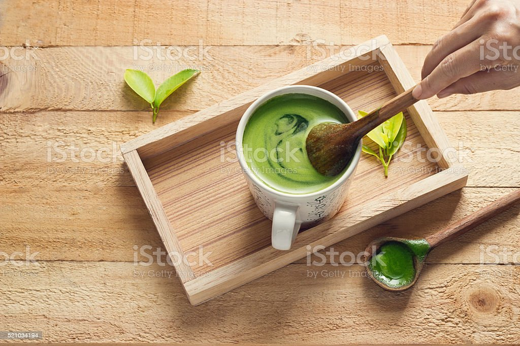Detox green tea, refreshing for health on wooden tray background stock photo