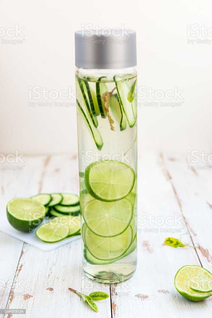 Detox Infused Water with Cucumber, Lime and Mint in Bottle stock photo