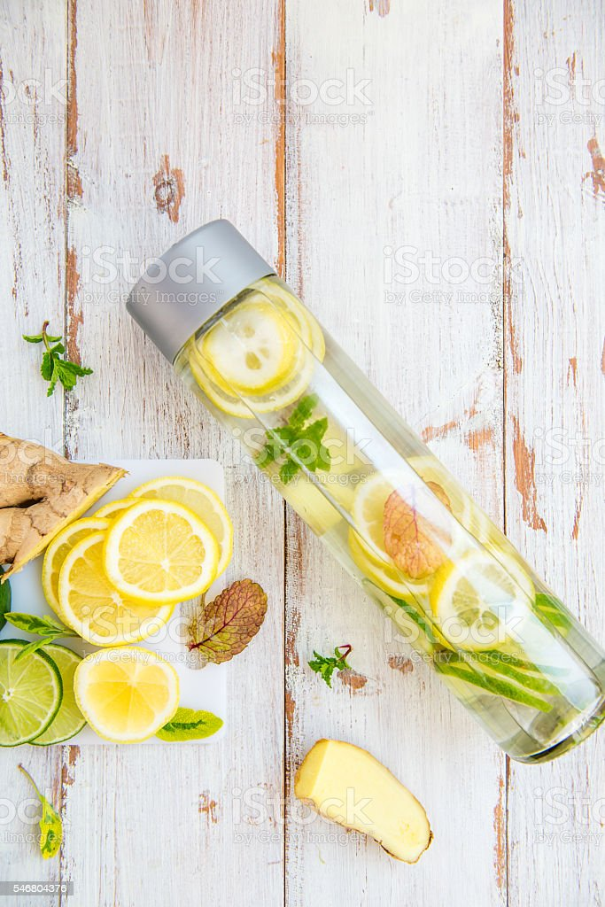 Detox Infused Water with Lemon, Lime, Ginger Lemonade stock photo