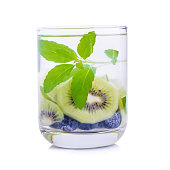 Detox water with Blueberries, kiwi and basil leaves.