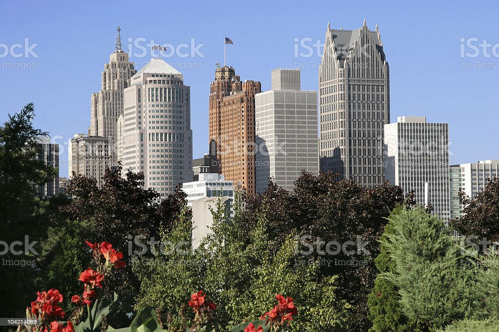 Detroit skyscrapers behind treetops stock photo