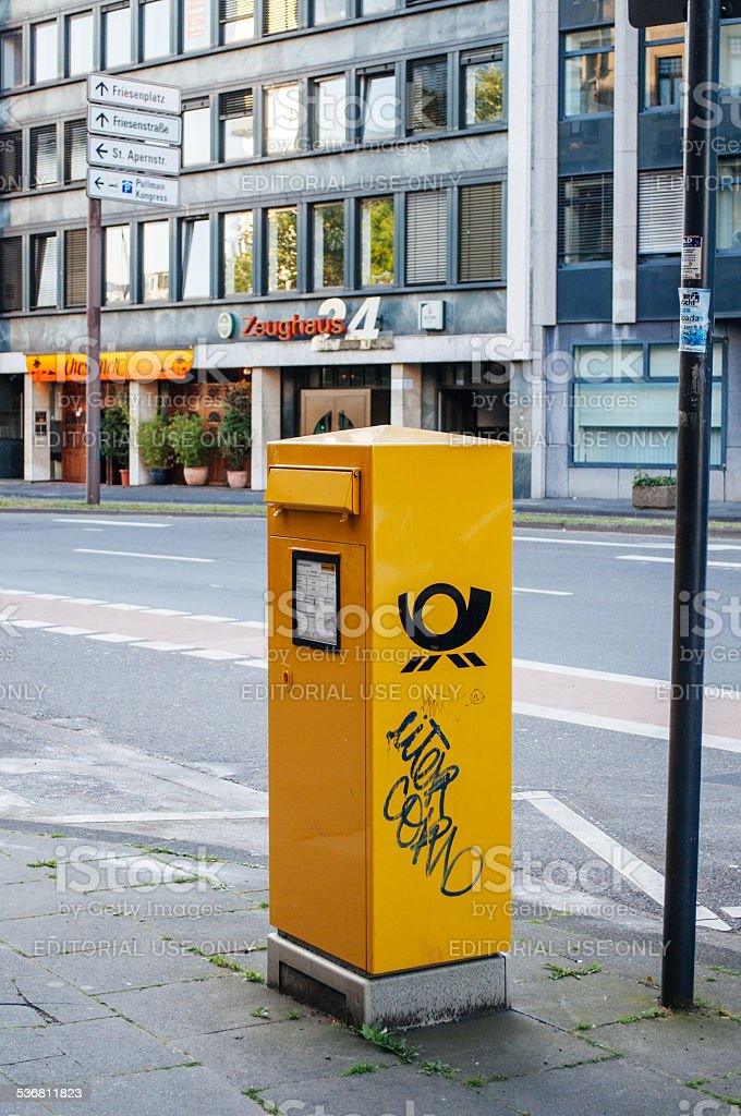 Deutsche Post DHL - mailbox in the city stock photo