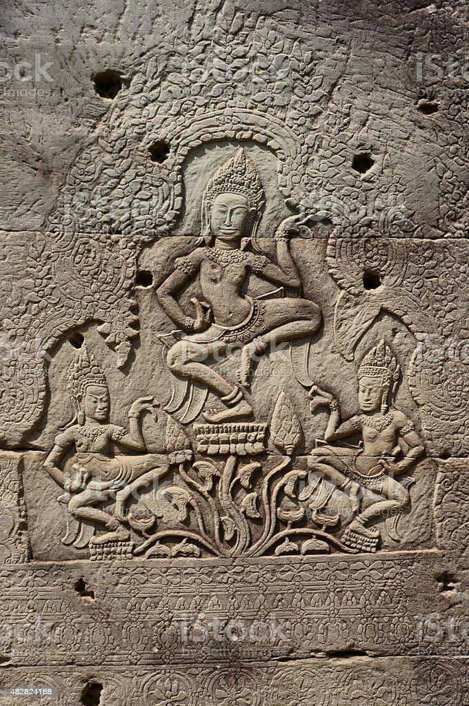 Deva sculptural relief at Bayon, Cambodia stock photo