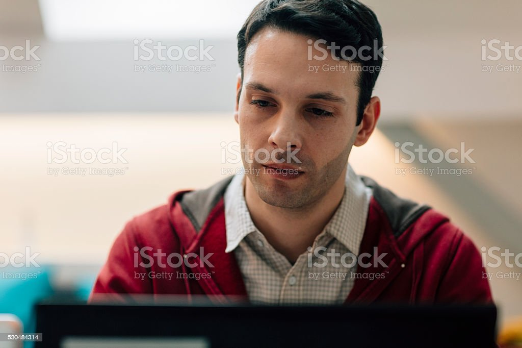 Developer Working In His Office. stock photo