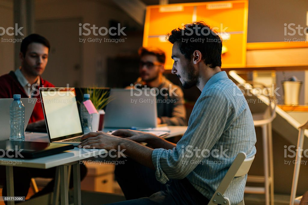 Developers Brainstorming in Their Office. stock photo