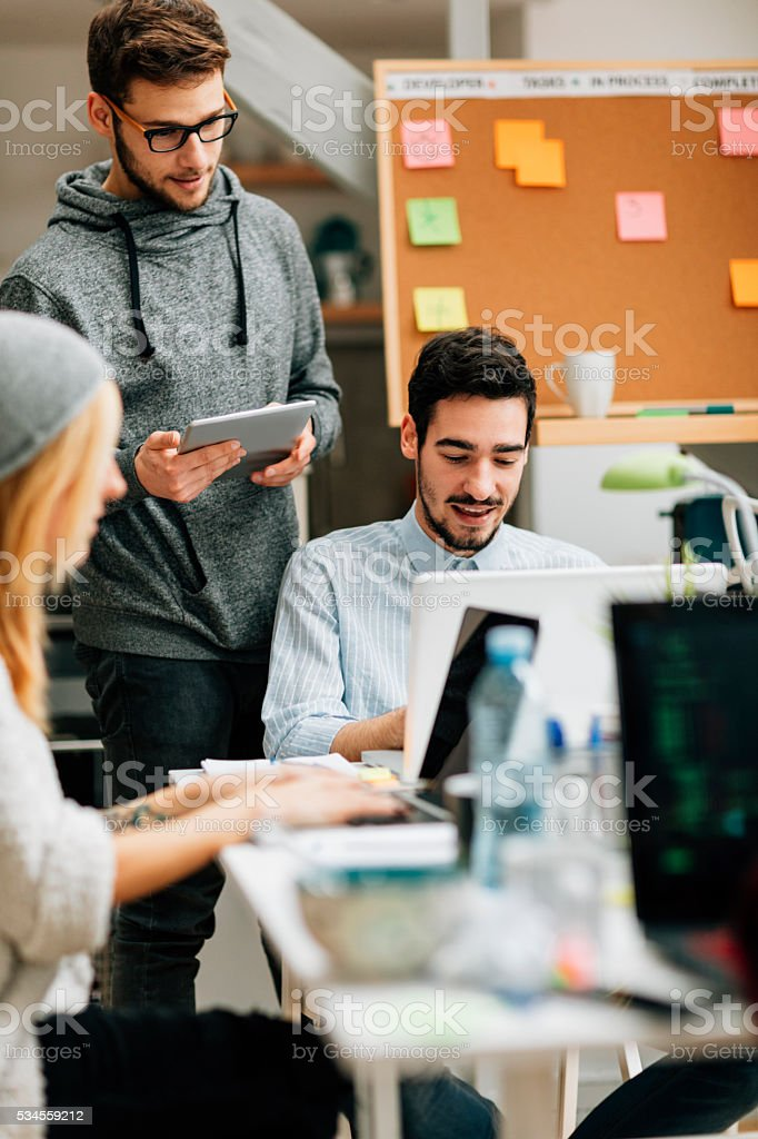 Developers Brainstorming In Their Start Up Office. stock photo
