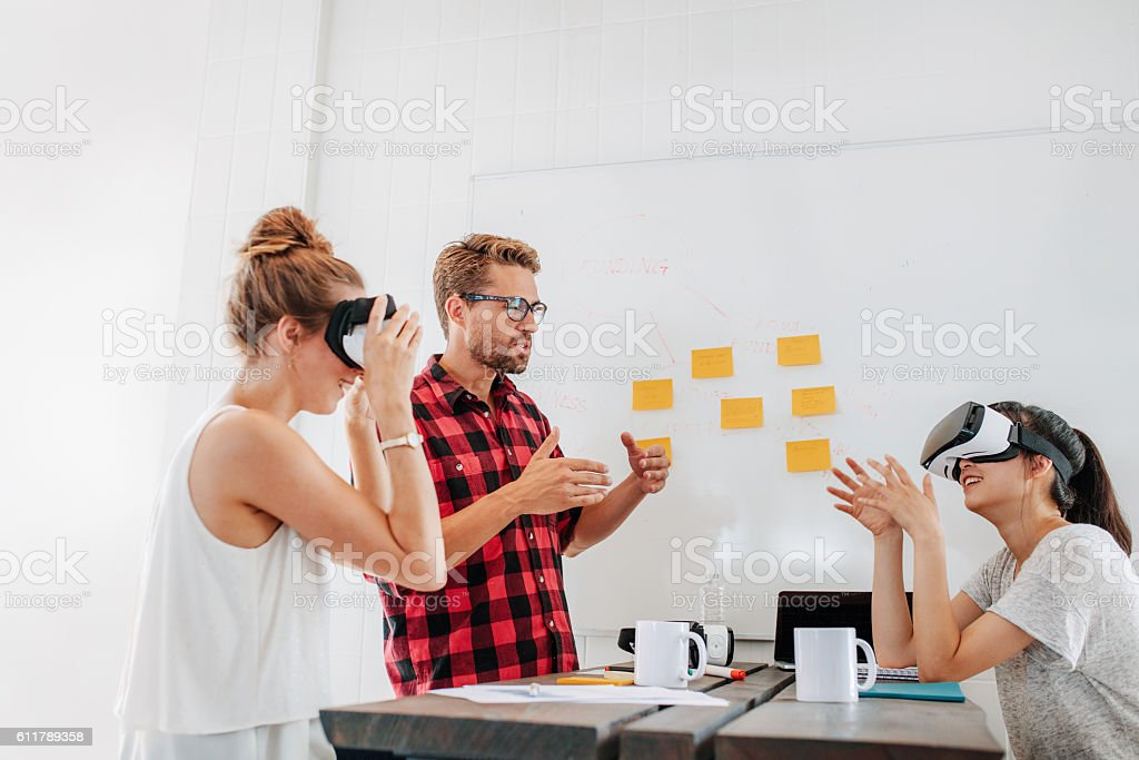 Developers brainstorming on augmented reality technology devices stock photo