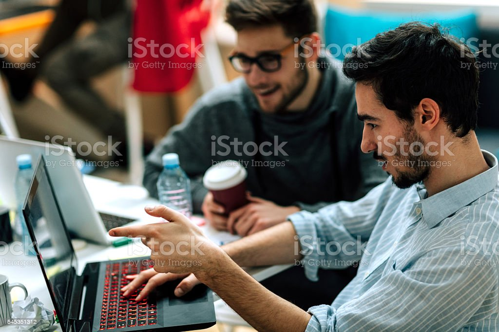 Developers Team Collaborating In Their Office. stock photo