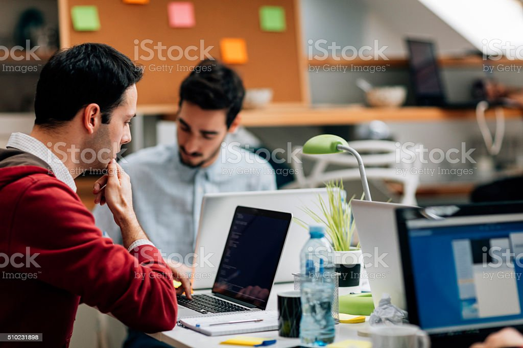 Developers Team In Their Office. stock photo