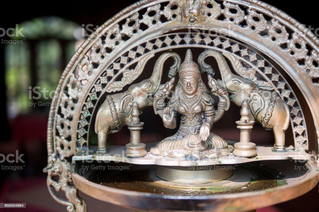 Devi Kamala indian goddess elephant sculpture stock photo