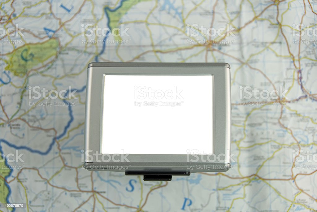 GPS device against traditional map. royalty-free stock photo