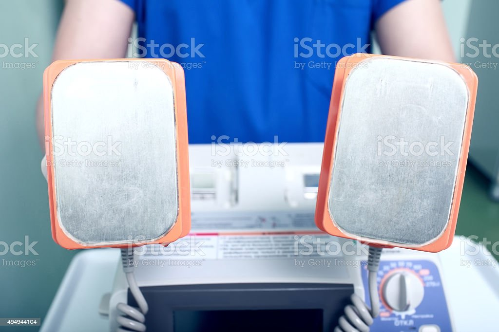 CPR device in doctors hand stock photo