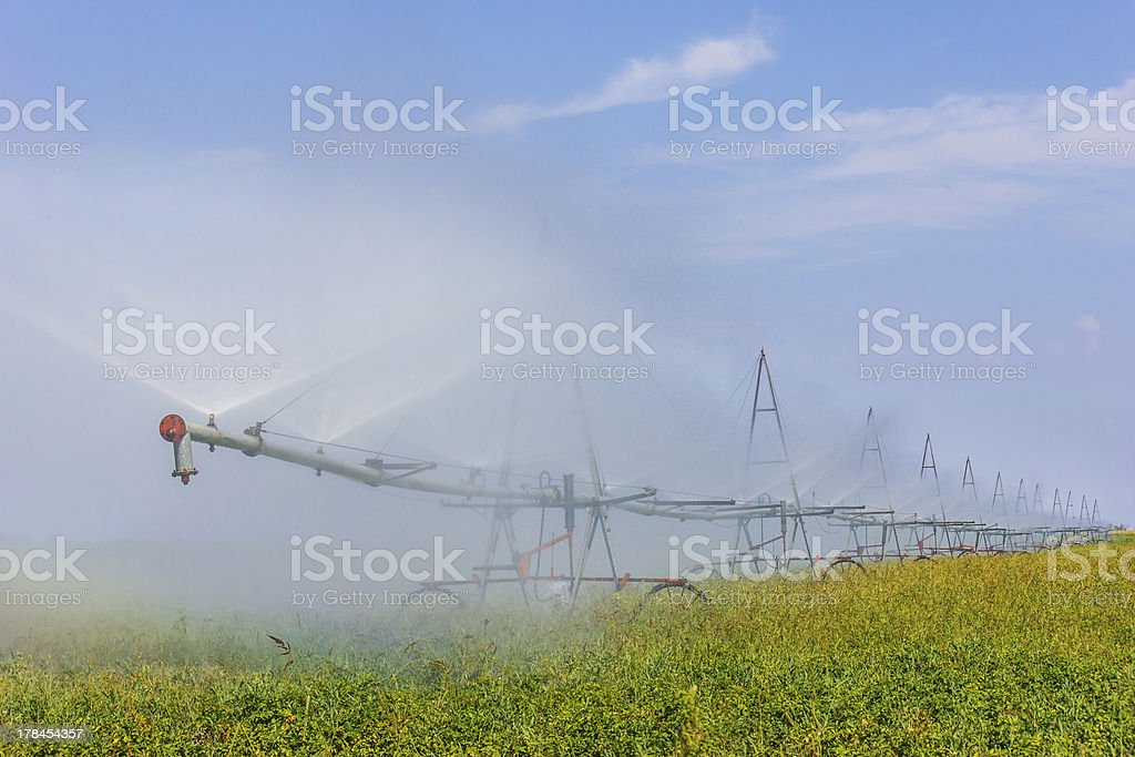 Device to water the fields stock photo
