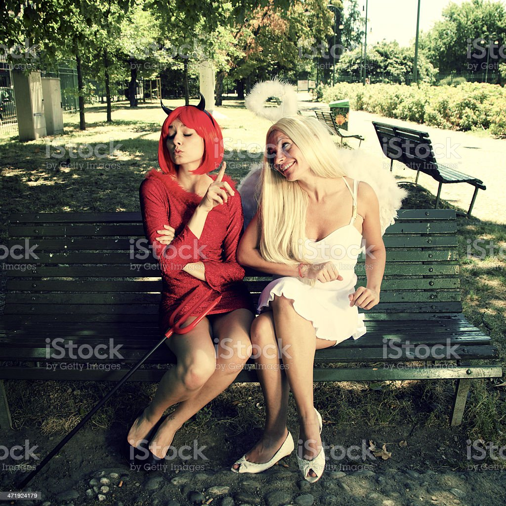 Devil and angel stock photo