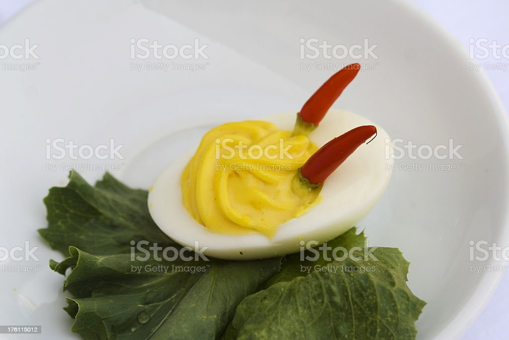 Devil Egg, with Red Chily Peppers stock photo
