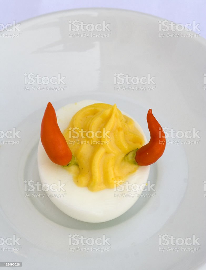 Devil Egg with Red Cili Peppers stock photo
